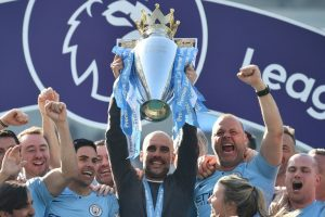 Manchester City's Pep Guardiola lifts EPL trophy